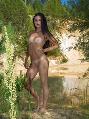 Celeste bares her slender, tanned body outdoors.