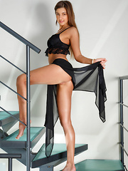 Melena A strips on the stairs as she bares her lusty body.