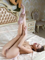 Sandra Lauver's inviting looks and tempting smile as she spreads her legs wide open on top of an elegant bed